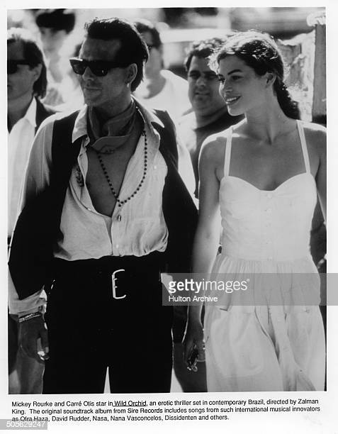 Mickey Rourke and Carre Otis walk in a scene from the movie 'Wild Orchid' circa 1989