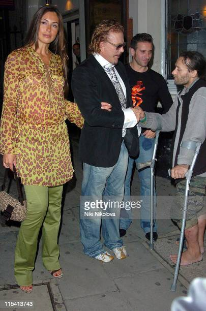 Mickey Rourke and guest during Mickey Rourke Sighting at The Wellington Club in London August 17 2005 at Wellington Club in London Great Britain