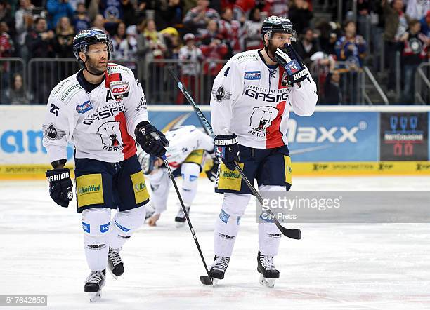 Micki DuPont and Henry Haase of the Eisbaeren Berlin during the DEL playoff match between Koelner Haie and the Eisbaeren Berlin on March 26 2016 in...