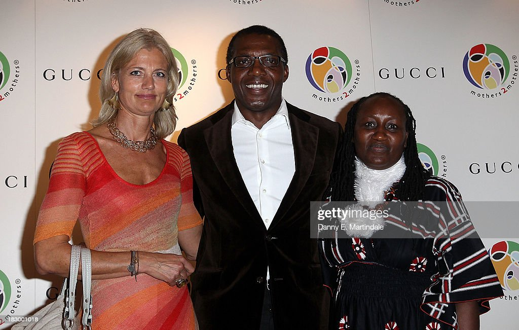 Micki Rogers, Carl Stewart and Jane Njoki Peris attend the mothers2mothers cocktail party to celebrate reaching one million mothers in partnership with GUCCI at One Marylebone on October 3, 2013 in London, England.