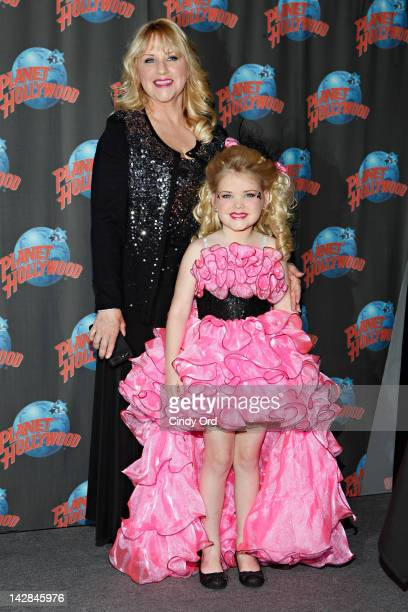 Micki Wood poses with her daughter Eden Wood as she Promotes Her New Series 'Eden's World' At Planet Hollywood on April 13 2012 in New York City