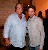 Micky Arison and Jerry Bruckheimer are seen at Seasalt and Pepper Restaurant on May 25 2014 in Miami Florida