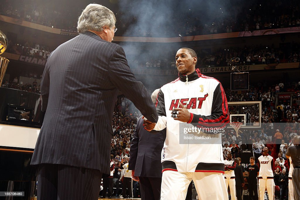 Micky Arison congratulates Mario Chalmers #15 of the Miami Heat as he receives his championship ring prior to the game against the Boston Celtics on October 30, 2012 at American Airlines Arena in Miami, Florida.