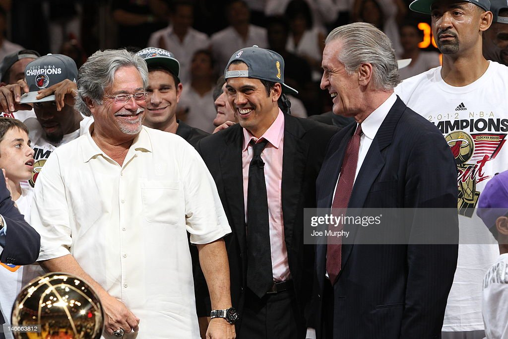 Micky Arison, Miami Heat owner, Erik Spoelstra, head coach of the Miami Heat and Pat Riley, team president share a laugh as the Miami Heat defeated the Oklahoma City Thunder in Game Five of the 2012 NBA Finals at American Airlines Arena on June 21, 2012 in Miami, Florida.