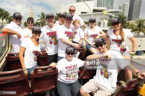 Micky Arison owner and Pat Riley president of the Miami Heat celebrates during the championship celebration parade through downtown on June 24 2013...
