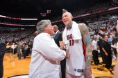 Micky Arison owner of the Miami Heat congratulates Chris Andersen after winning Game Seven of the Eastern Conference Finals against the Indiana...