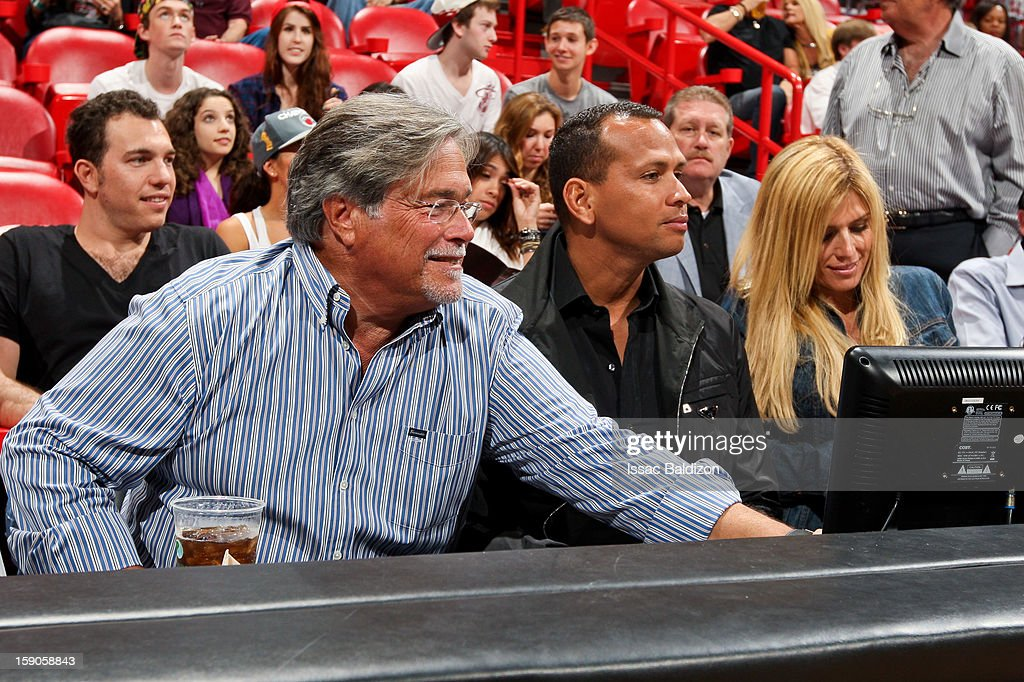 Micky Arison owner of the Miami Heat left speaks with Alex Rodriguez of the New York Yankees before an NBA game between the Heat and the Washington...