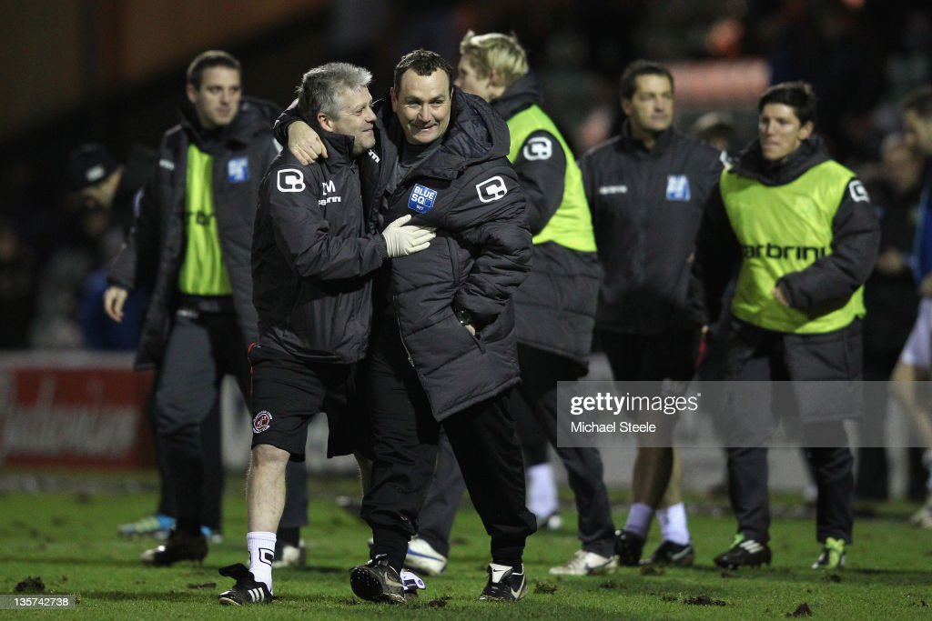 Micky Mellon manager of Fleetwood Town celebrates his sides 20 victory alongside assistant Craig Madden during the FA Cup Second Round Replay match...
