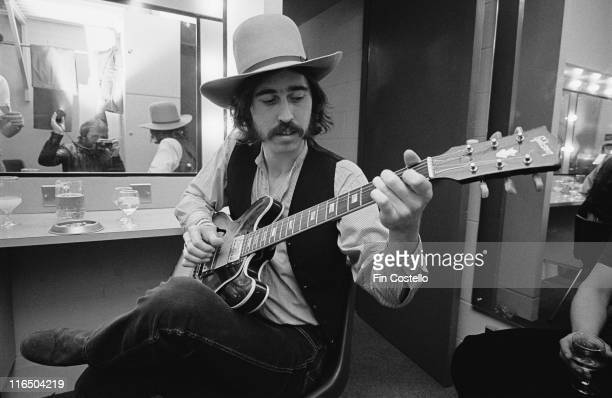 Micky Moody British guitarist with Whitesnake sittng backstage playing a guitar at the Hexagon theatre in Reading Berkshire England Great Britain 25...