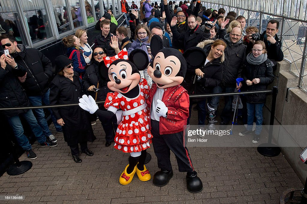 Micky Mouse and Minnie Mouse of Disney Live! MickeyÕs Music Festival visits The Empire State Building on March 20, 2013 in New York City.