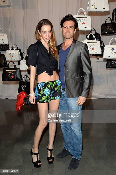 Micol Sabbadini and Carlo Mazzoni attend the Porsche Design x Thierry Noir Art Basel Miami Beach Event at The Temple House on December 3 2013 in...