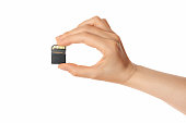 micro sd card and hand (isolated)