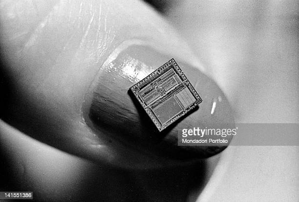 A microcomputer placed on a woman's nail February 1981