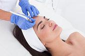 Beautiful woman having a beauty treatment in spa.