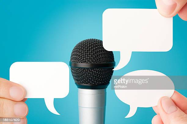 Microphone and three blank speech bubbles