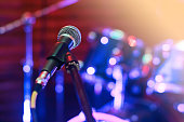 Microphone at concert on the stage with colorful light