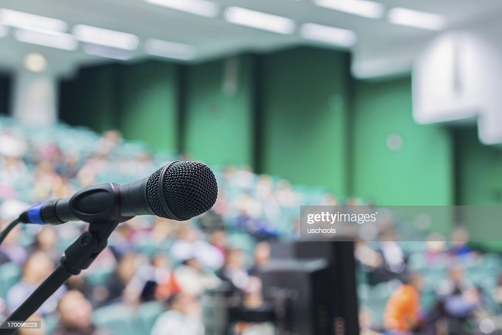 Microphone in front of people : Stock Photo