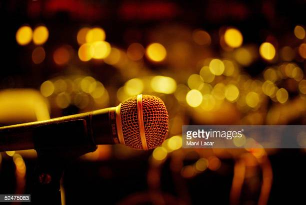 A microphone is set on stage where the Cotton Club All Stars band play swing music in the Harlem neighborhood June 21 2004 in New York City The...