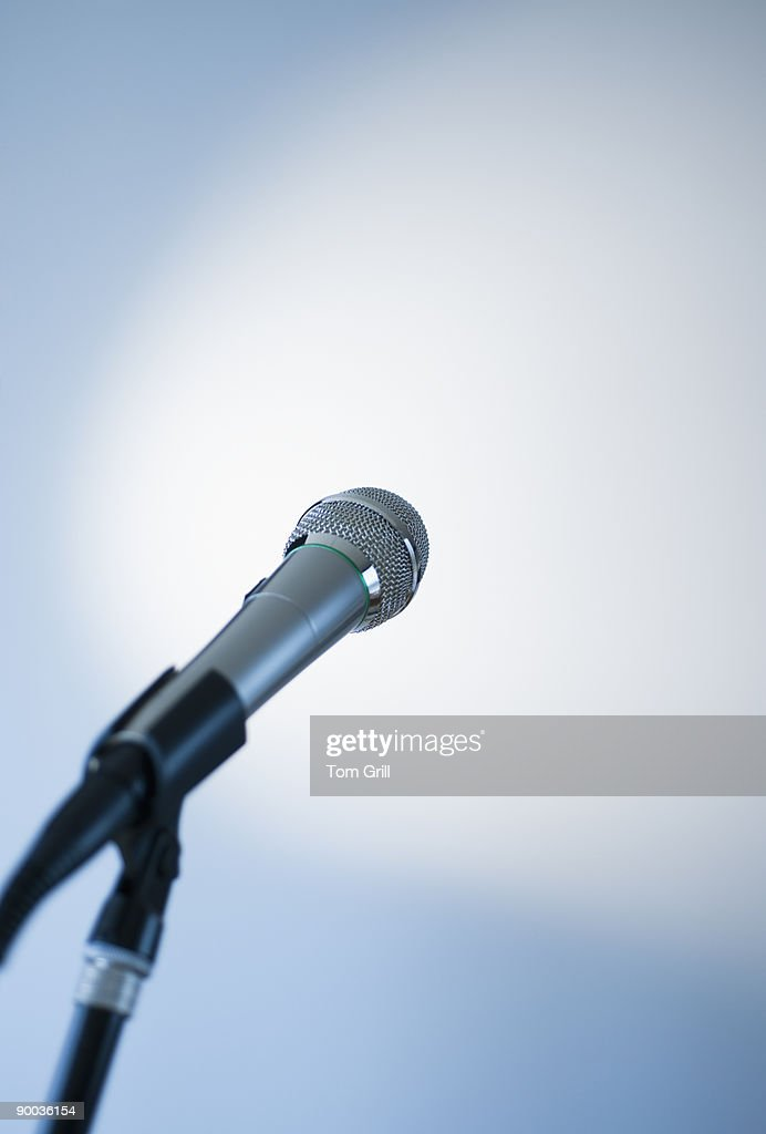 Microphone on a stand waiting for speaker : Stock Photo