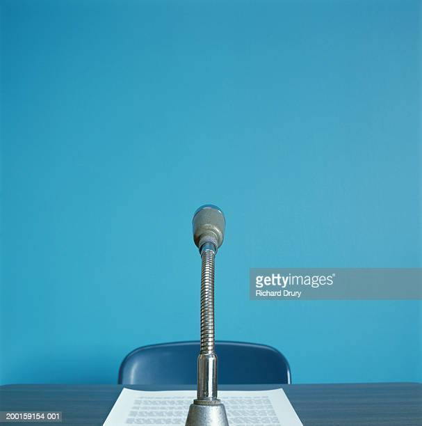 Microphone on desk by paper