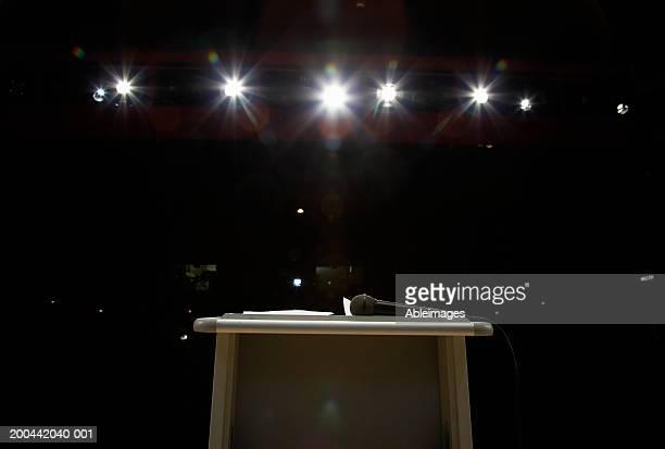 Microphone on lectern in illuminated auditorium