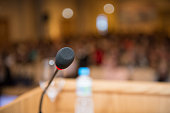 microphone with a blurred background audience lecture