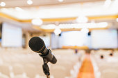 Microphone stand in conference hall. Public announcement event, Organization company meeting, or graduation award ceremony concept