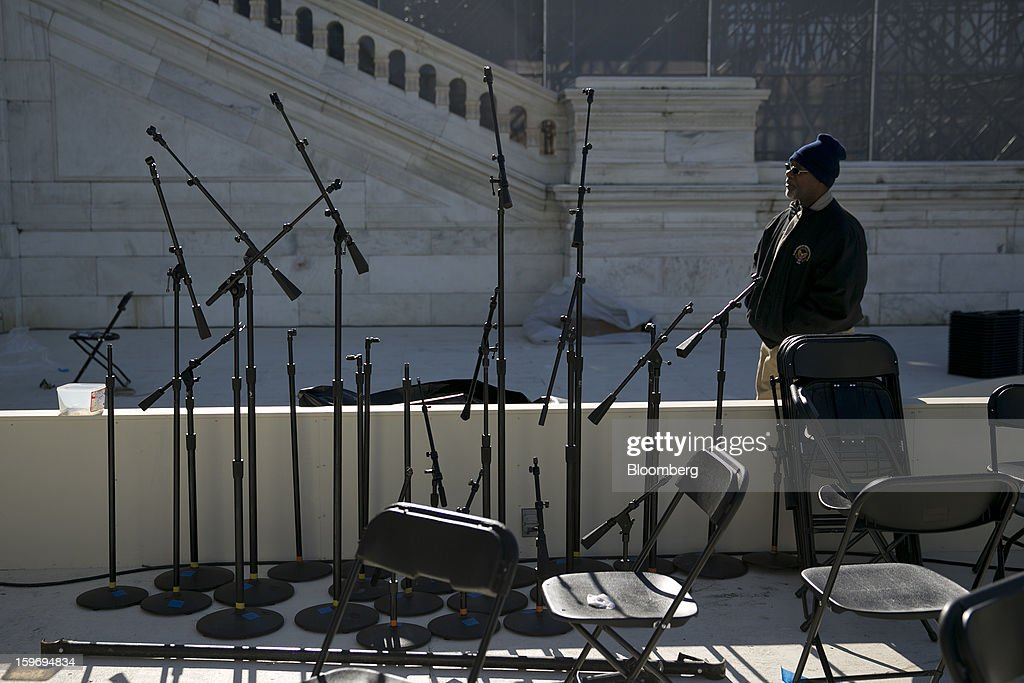 Microphone stands wait to be positioned outside the U.S. Capitol prior to the second inauguration of U.S. President Barack Obama in Washington, D.C., U.S., on Friday, Jan. 18, 2013. President Obama's second inauguration next week will combine the star power of Beyonce, Kelly Clarkson and James Taylor with a lineup that reflects social values Obama will champion in his new term. Photographer: Andrew Harrer/Bloomberg via Getty Images