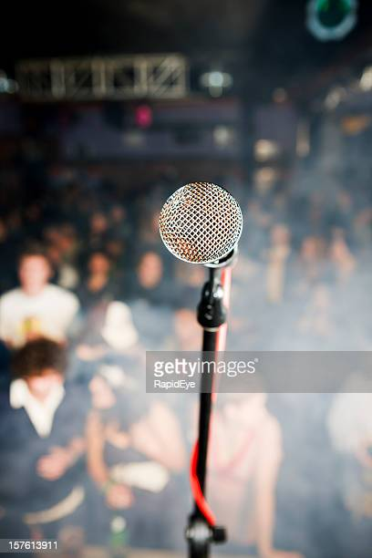 Microphone viewed from stage towards out-of-focus audience