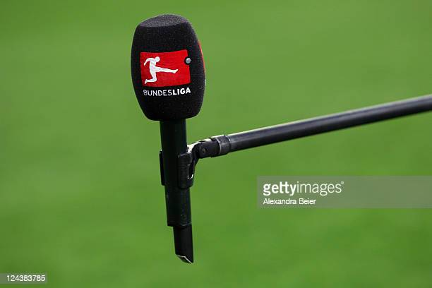 A microphone with a Bundesliga logo is pictured before the Bundelsliga match between FC Augsburg and Bayer 04 Leverkusen at SGL Arena on September 9...