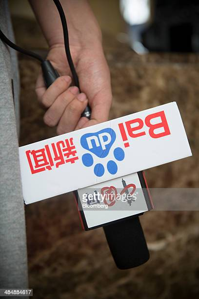 A microphone with Baidu Inc branding is held at the Boao Forum for Asia in Boao Hainan China on Thursday April 10 2014 The Boao Forum for Asia takes...