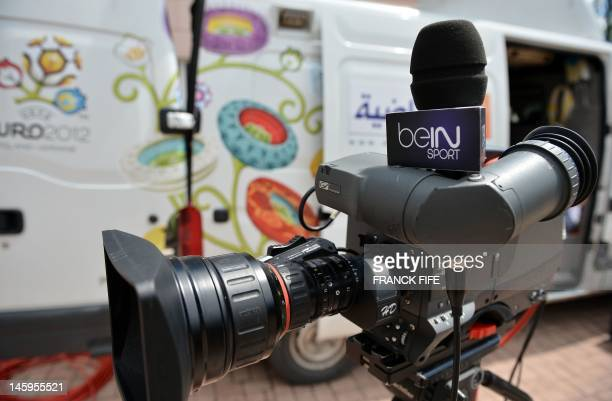 A microphone with the logo of recently launched French TV Sport channel BeIN Sport that belongs to Qatari media group AlJazeera is seen on June 7...
