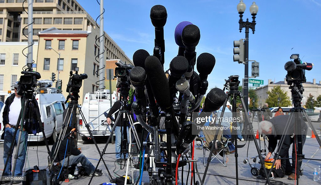 Microphones and news crews waited for news on the Chris Brown hearing at the H. Moultrie Courthouse on Monday, October 28, 2013 in Washington, DC.