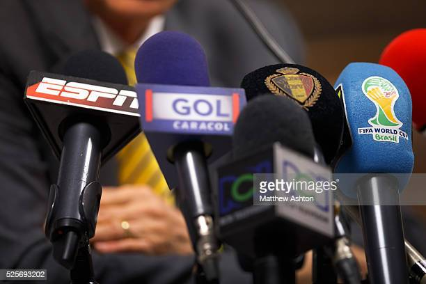 Microphones at a press conference with ESPN GOL Caracol and the FIFA 2014 World Cup Brazil logo on