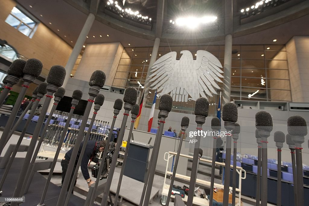 Microphones stand at the plenary hall of the Bundestag (lower house of parliament) on January 18, 2013 in Berlin. Germany and France will be celebrating the 50th anniversary of the Elysee Treaty on January 22, 2013, among others with a common session of German and French delegates at the German Bundestag. AFP PHOTO / BARBARA SAX