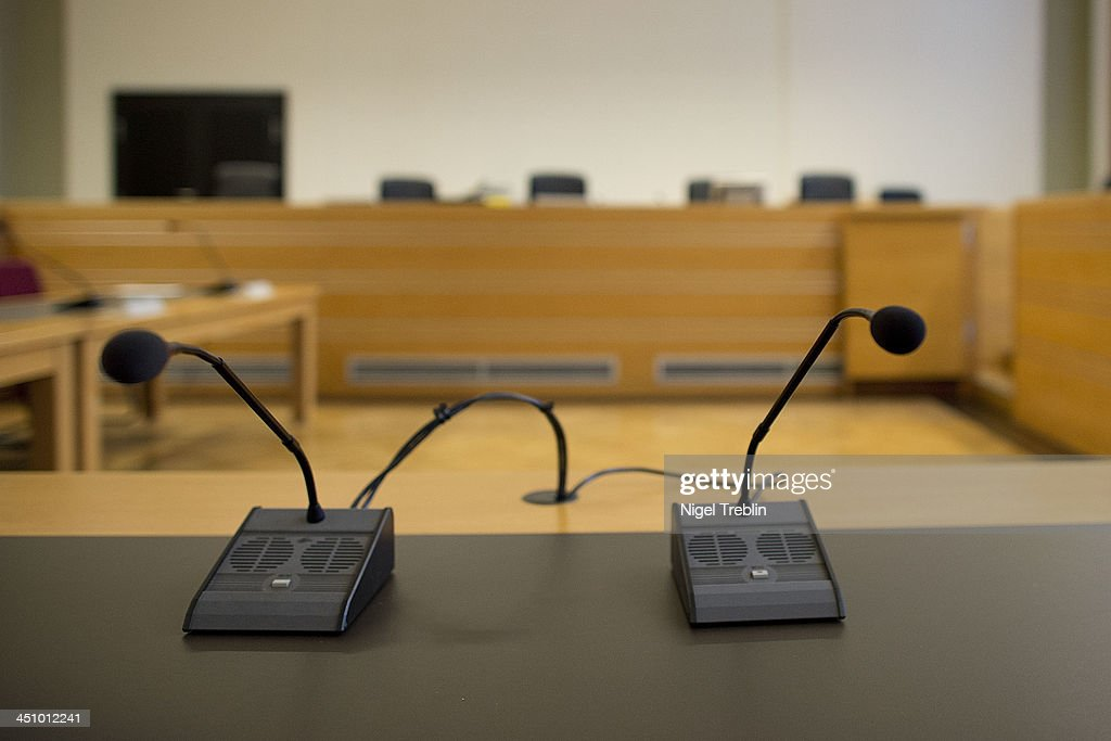 Microphones stands in the courtroom at the Landgericht Hannover courthouse for the second day of their trial to Former German President Christian Wulff and defendant David Groenewold on November 21, 2013 in Hanover, Germany. Wulff is accused of accepting favors while he was governor of Lower Saxony, a charge that prompted him to resign last year from his office as president. Wulff is the first post-World War II German president to face a court trial.