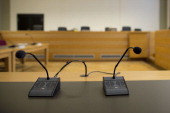Microphones stands in the courtroom at the Landgericht Hannover courthouse for the second day of their trial to Former German President Christian...