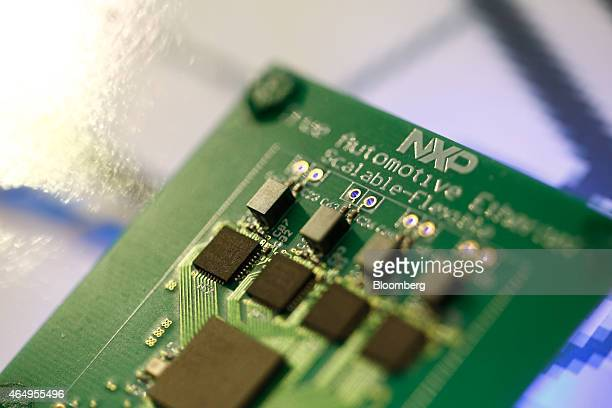 Microprocessors sit on a circuit board labelled 'true Automotive Ethernet' displayed on the NXP Semiconductors NV pavilion at the Mobile World...