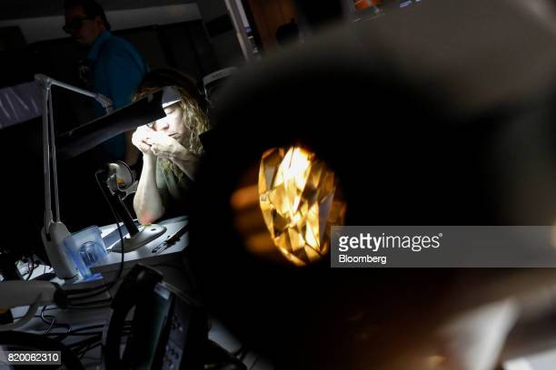 A microscope magnifies a diamond as an employee checks the quality of diamonds at the Antwerp World Diamond Center in the diamond district of Antwerp...