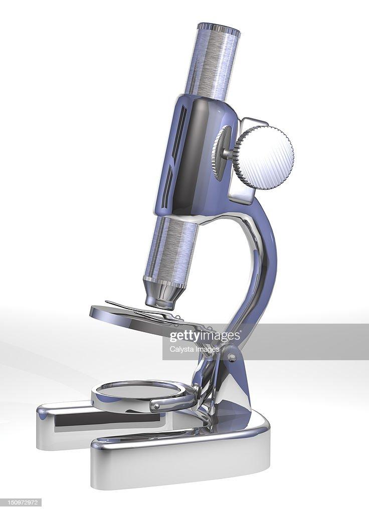 Microscope on grey background : Stock Photo