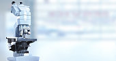 Scientific microscope in laboratory. Health care background.