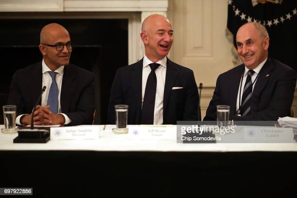 Microsoft CEO Satya Nadella Amazon CEO Jeff Bezos and White House Director of Strategic Initiatives Chris Liddell share a laugh before a meeting of...