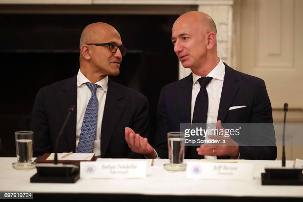 Microsoft CEO Satya Nadella and Amazon CEO Jeff Bezos visit before a meeting of the White House American Technology Council in the State Dining Room...