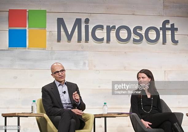 Microsoft CEO Satya Nadella and CFO Amy Hood answer questions during the Microsoft Shareholders Meeting December 3 2014 in Bellevue Washington The...