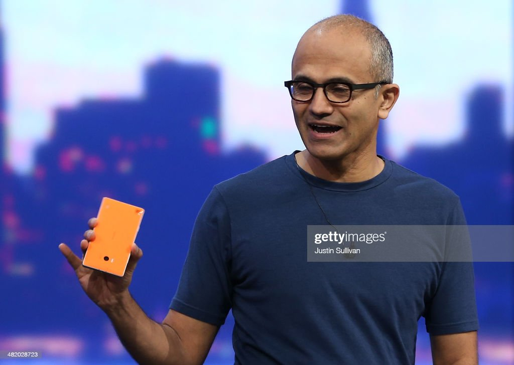 Microsoft CEO Satya Nadella holds a new Nokia Lumia 930 as he delivers a keynote address during the 2014 Microsoft Build developer conference on...