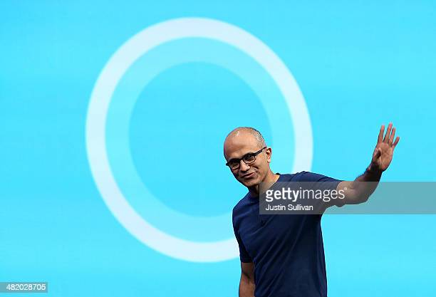 Microsoft CEO Satya Nadella walks in front of the new Cortana logo as he delivers a keynote address during the 2014 Microsoft Build developer...
