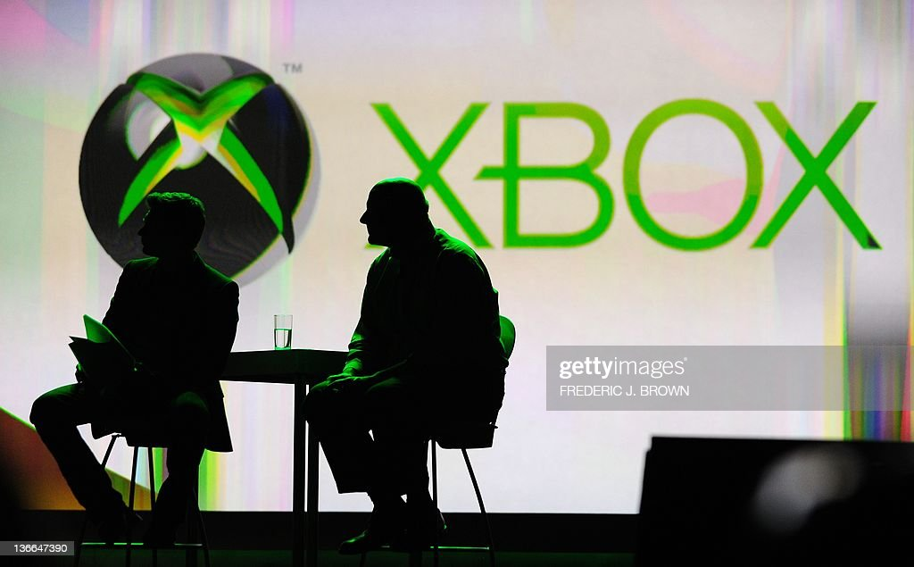 Microsoft CEO Steve Ballmer (R) and host Ryan Seacrest (L) watch as Craig Davison, Senior Director for Xbox makes his presentation during the keynote address for CES 2012 at the annual Consumer Electronics Show on January 9, 2012 in Las Vegas, Nevada. AFP PHOTO / Frederic J. BROWN