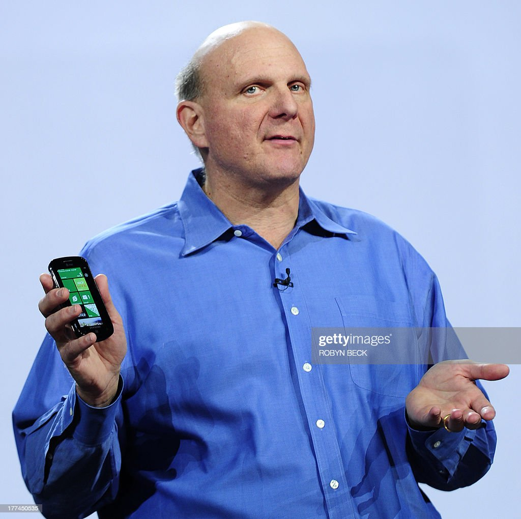 Microsoft CEO <a gi-track='captionPersonalityLinkClicked' href=/galleries/search?phrase=Steve+Ballmer&family=editorial&specificpeople=211258 ng-click='$event.stopPropagation()'>Steve Ballmer</a> holds a Windows Phone 7 during his keynote speech at the 2011 International Consumer Electronics Show January 5, 2011 in Las Vegas, Nevada. CES, the world's largest annual consumer technology tradeshow, officially runs from January 6-9. AFP PHOTO / Robyn Beck