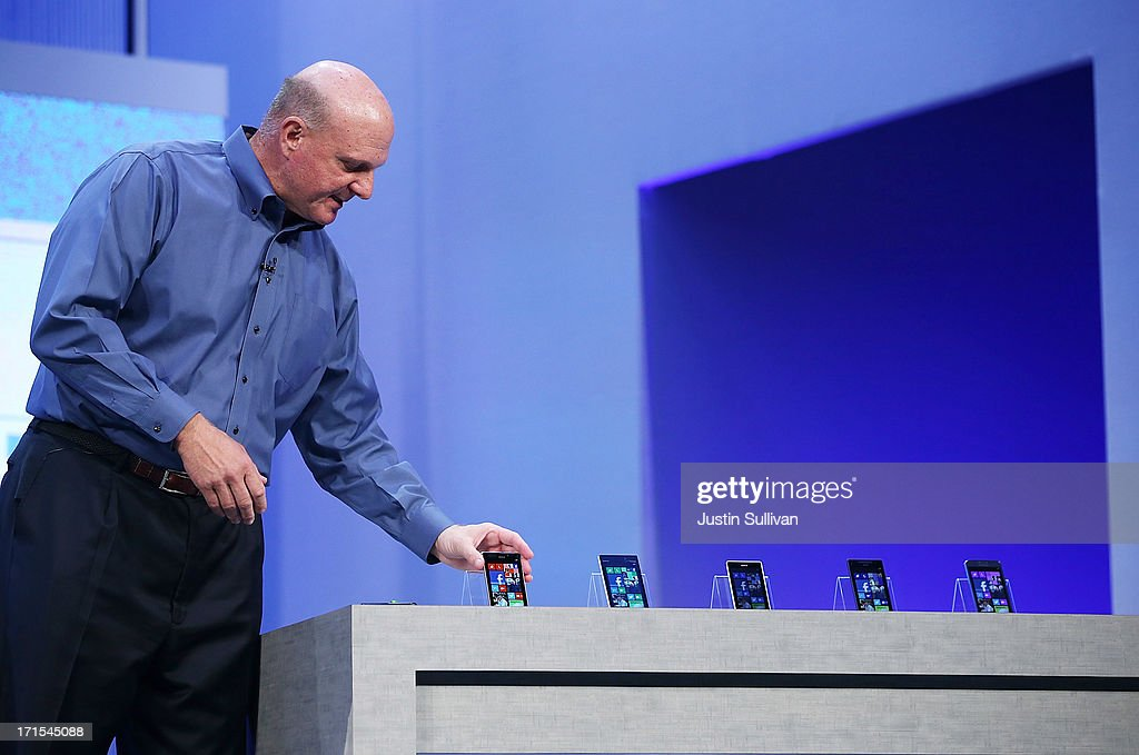 Microsoft CEO Steve Ballmer looks at a display of Windows phones as he speaks during the keynote address during the Microsoft Build Conference on June 26, 2013 in San Francisco, California. Microsoft debuted an upgrade to their Windows 8 operating system during the Microsoft Build Conference that runs through June 28.