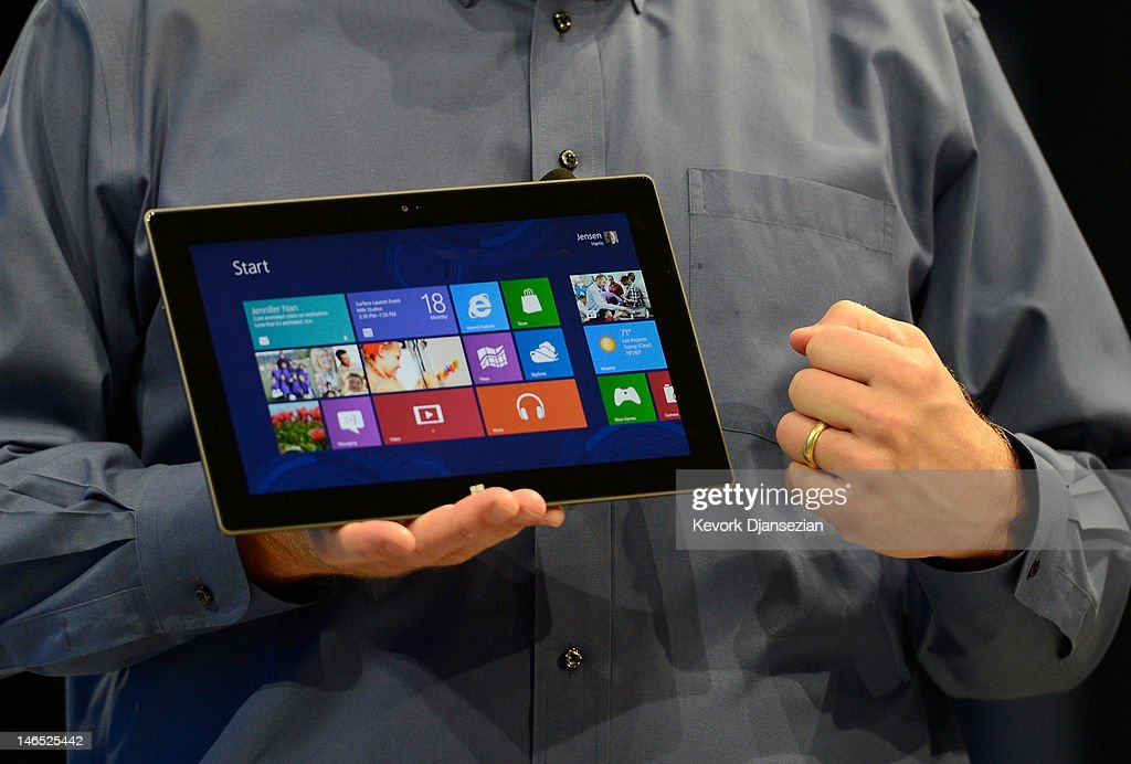 Microsoft CEO Steve Ballmer shows the new tablet called Surface during a news conference at Milk Studios on June 18, 2012 in Los Angeles, California. The new Surface tablet utilizes a 10.6 inch screen with a cover that contains a full multitouch keyboard.